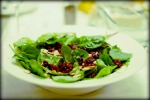 Simple spinach salad with cranberries and sliced almonds. Served with poppy seed dressing